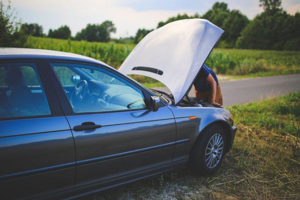 road-man-broken-car
